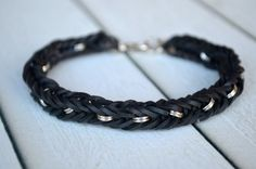 Rainbow Loom friendship bracelet rubber bands black with metal pieces