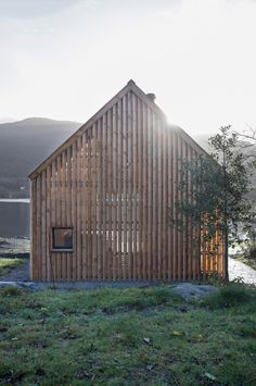 An old boathouse on Norway's west coast has been transformed into a summerhouse that becomes a glowing beacon at night