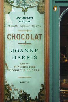 Chocolat by Joanne Harris https://www.amazon.com/dp/0140282033/ref=cm_sw_r_pi_dp_x_ydrKyb8Z478RT