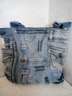 Women's bag of jeans. Stylish bag of recycled jeans. An old jeans. Denim bag with lining.Hobo denim bag made from recycled jeans with pockets and lining Trend 2019 Trend 2019 Hobo denim bag made from recycled jeans withLevi's denim purse with graffit Denim Tote Bags, Denim Purse, Jean Purses, Travel Bags For Women, Women Bags, Mode Jeans, Denim Ideas, Denim Crafts, Shoes With Jeans