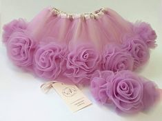 Beautiful ruffly baby tutu and flower baby skirt are the ideal first present baby! This light mauve tutu is made of a double layer of tulle and a layer of taffeta. With an elasticated waist for a comfortable secure fit, this skirt is perfect for any baby on the move. The set comes with a #babyskirts