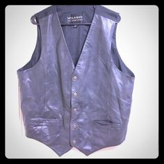 Wilsons Genuine Leather Button Down Vest The is an authentic Wilsons leather garment. This best has 5 front button snaps, two small front pockets, an adjustment strap in the back , and has the classic W bottom formation with a crisp cut. This vest is gender neutral and is perfect for a woman or a man. Wilsons Leather Jackets & Coats Vests