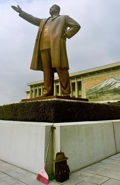 Brooms should never to be placed at the base of official statues - Banned Photos Showing The Real Life in North Korea  Best of Web Shrine