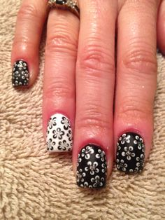 Black and white flowers done in Gelish gel polish