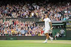 Roger Federer celebrates after defeating Novak Djokovic and advancing to the Championship Round. - Jon Buckle/AELTC