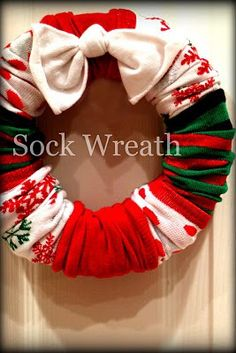 sock wreath!! Hey couldn't you go to the thrift store and do this with sleeves?  Sweaters, pants?  Imagination!
