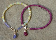 Ethiopian opal w/ tanzanite and ruby stacking bracelets.