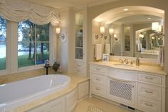 Liking the surround on this tub.....mix of wood and tile
