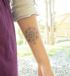 Pretty compass tattoo