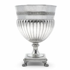A large Fabergé silver champagne cooler, workmaster Stefan Väkevä (Wäkeva), St Petersburg, 1899-1903, in neoclassical taste, the gadrooned bowl with palmette border, the knopped stem cast with bound reeds and acanthus, the square base with entrelac borders, four paw feet. This impressive cooler is perhaps the largest Fabergé object of its type known to exist.