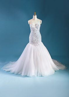 A woman wearing the Ariel wedding gown from the Alfred Angelo Bridal Collection