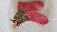 Hand knitted socks using five knit needles