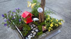 A fairy garden for our babysitter for Childcare provider appreciation day. Reused a container, had daughter paint $1 birdhouse from Joanne's and decorated with rocks, bought some pretty flowers, and wooden fence, Voila!