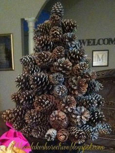 Pine cone Christmas tree, make with scented pinecones and top with a red ribbon!