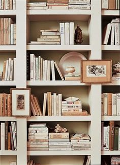 Books, art and sentimental pieces pack a punch in this pretty bookcase.  Laurel Bern Interiors via Pinterest