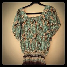 Sheer print top This top is perfect for summer! Goes great over a tank top as it is slightly sheer. Elastic towards the bottom to accentuate the waist. Beautiful pattern of teal, brown and cream paisley. Mudd Tops Blouses