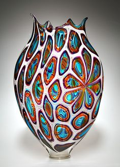 This blew my mind with it's handcrafted individuality and colourful beauty...imagine it in front of a window?  By David Patchen