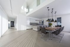 Image 9 of 22 from gallery of House 19 / Jestico + Whiles. Photograph by Grant Smith Cabinet Lighting, Home Kitchens, Storage Spaces, Kitchen Decor, Room Decor, House Design, Flooring, Architecture, Photograph