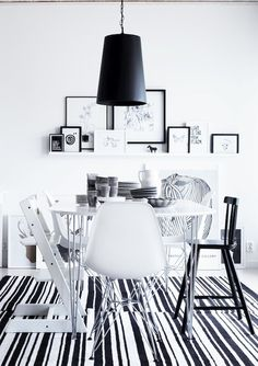 Like the framed pictures. And I would rather grey walls and for all of the chairs to be the same...