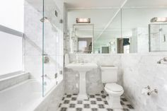 You've Got To See This: 30 Small Bathrooms That Are BIG In Style: Glossy Surfaces Make Small Bathroom Look Bigger
