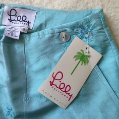 NWT Lilly pulitzer blue silk pants! Button and sparkle details! Brand new and never worn! Has under layer Lilly Pulitzer Pants