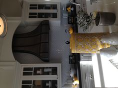 Gray and yellow kitchen. different but cool color combo.