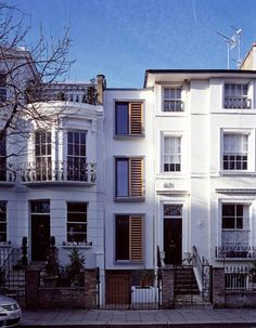 Houses in Bayswater, London...reminded me of Grimmauld Place.