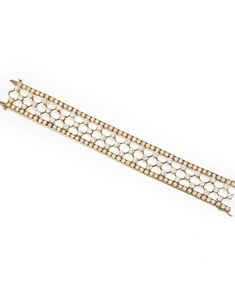 18 KARAT GOLD AND DIAMOND 'SNOWFLAKE' BRACELET, VAN CLEEF & ARPELS. The articulated strap of lattice-work design, set with numerous round diamonds weighing approximately 25.45 carats, length 7¼ inches, signed Van Cleef & Arpels, numbered 40681, with maker's mark.