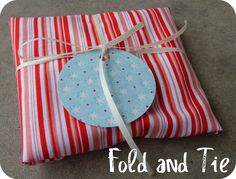 the red kitchen: Reusable Christmas Wrap #5--Mega Easy Fold and Tie