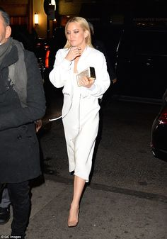 Truly stunning: The Almost Famous actress looked gorgeous in a slinky white dress with a c...