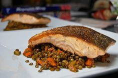 Pan Seared Salmon w/ French Green Lentils  by mtlabor via food52 who crisps the skin on the stove top and finishes it in the oven for a perfect result. #Salmon #Lentils #mtlabor #food52