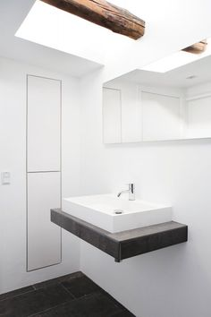 Bathroom vanity under skylight. Fredgaard Penthouse by Norm Architects