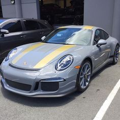 A PTSRS Exclusive shot of North America's only known paint to sample Nardo Grey (nardograu; non-metallic UNI; Y7C) 911 R, delivered earlier this year to Porsche of Hawaii in Honolulu. Need info on chassis number. This brings the worldwide Nardo Grey 911 R count to 2, with the other example being Lebanon's only 911 R in Beirut. Both examples sport a very similar theme with the main stripes in Yellow, but the wheels on this example are painted in matching Nardo Grey. Clear tails out in the…