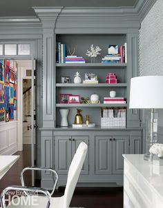 The millwork and built-ins in the wife's office were updated with glossy gray paint.