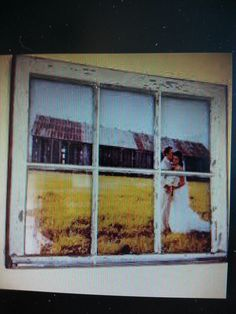 Place a wedding portrait or engagement photo behind a window pane