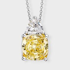 Fancy cubic zirconia pendant features a 3.5 carat cushion cut simulated yellow diamond accented with 0.55 carat trillion on top. An approximate 4.05 total carat weight, set in 14k white gold. An Italian cable chain is included, with your choice of 16 inch or 18 inch length. This high quality cubic zirconia pendant is also available in 14k yellow gold via special order. Cubic zirconia weights refer to equivalent diamond carat size.