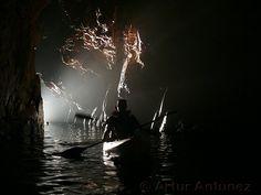 Cova d'en Gispert.  Kayaking in sea caves near Taramiu, Costa Brava, Spain.