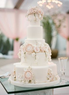Delicate wedding cake with ivory fondant and blush and ivory sugar flowers of dahlias, roses, sweet pea and hydrangea ~ we ❤ this! moncheribridals.com