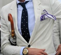 Shop this look for $256: http://lookastic.com/men/looks/white-and-blue-dress-shirt-and-navy-and-white-tie-and-white-and-violet-pocket-square-and-beige-blazer/1543 — White and Blue Vertical Striped Dress Shirt — Navy and White Polka Dot Tie — White and Violet Pocket Square — Beige Blazer