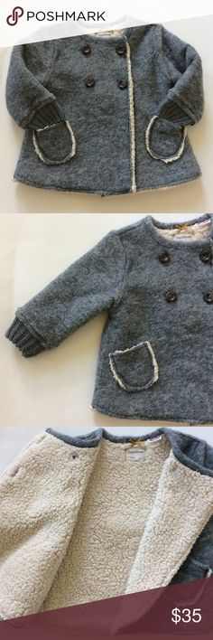 👫Zara Baby Girl Knitwear coat Zara Baby Girl Knitwear coat. Super cute and warm💜 Grey outer with cream colored faux shearling on the inside. Really soft. 2 pockets in front. Buttons. Sweater knit around the wrists. Interior 100% polyester, exterior 47 wool 44 polyester 9 acrylic. Size 12-18 mths. Excellent condition., Zara Jackets & Coats