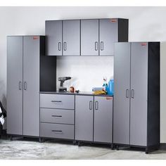 Tuff-Stor 6 Piece Storage System in Charcoal Grey and Textured Black by Tuff Stor. $1580.24. TS09-102 Features: -Adjustable European concealed hinges.-Durable 3 mm PVC edge banding.-Made in USA. Includes: -Includes 2 upper cabinets, 1 two door base cabinet, 1 three drawer base cabinet and 2 two door pantry. Construction: -SCS certified medium density fiberboard construction.-Steel bar construction for unsurpassed strength. Color/Finish: -Charcoal grey and textured black...