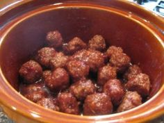 Drunken whiskey meatballs! Set it and forget it. Easy and tasty. Going in my pot luck arsenal.