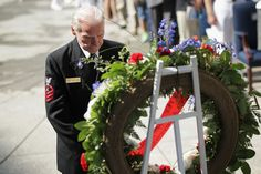 "Henry Kudzik Photos Photos - Former U.S. Navy Chief Petty Officer Henry ""Hank"" Kudzik observes a moment of slience in front of a wreath during a celebration of the 72nd anniversary of the Battle of Midway victory June 4, 2014 at the U.S. Navy Memorial in Washington, DC. The battle was one of the most important victories during the World War II after the Japanese attack to Pearl Harbor six months ago. - Veterans Mark Battle of Midway"