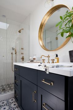 black vanity, gold round mirror, bathroom