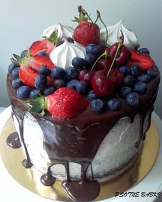 Drip cake with fresh fruits