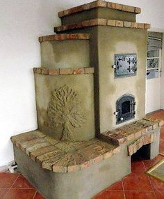 Love the of art on the stove. reminds me of germany Stove Fireplace, Fireplace Mantels, Fireplaces, Rocket Mass Heater, Wine House, Outdoor Oven, Tadelakt, Natural Homes, Rocket Stoves