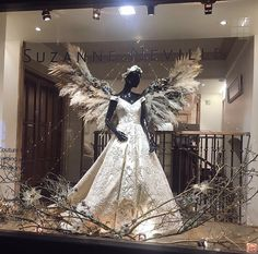 We are in love with our amazing Christmas window! Thank you so much Hiding in the City Flowers. It is beautiful!  Dress featured: 'Vienna'  #suzanneneville #christmas #christmaswindow #hidinginthecityflowers #floristry #angel #wings #couture #designerweddingdress #london