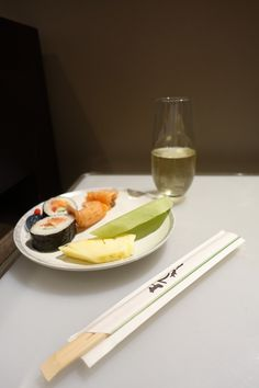 Plate of sushi and fruit, with a glass of Arras champagne in the Singapore Airlines Lounge in Perth - Virgin Australia International Business Class review