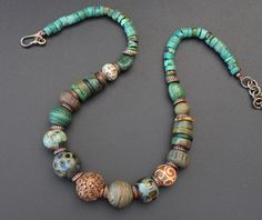 Absolutely unique necklace made of unique components from all over the world! Tibetan turquoise and copper, artisan ceramic beads by artists from UK, USA and Russia, artisan lampwork, carved agate, carved bone, vintage lucite bead.
