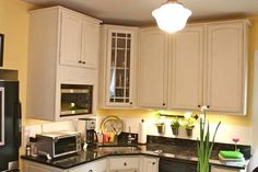 Kitchen cabinets using Ann Sloan chalk paint in Old White.
